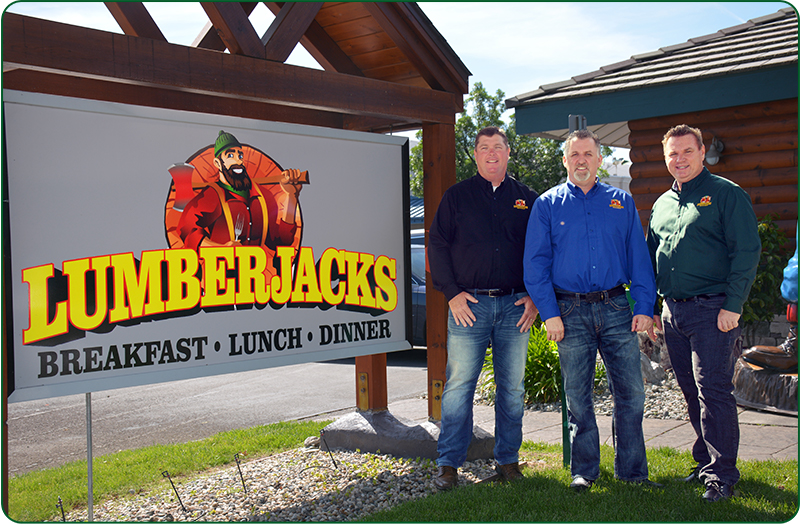 Lumberjacks Leadership Standing Outside Restaurant By Sign